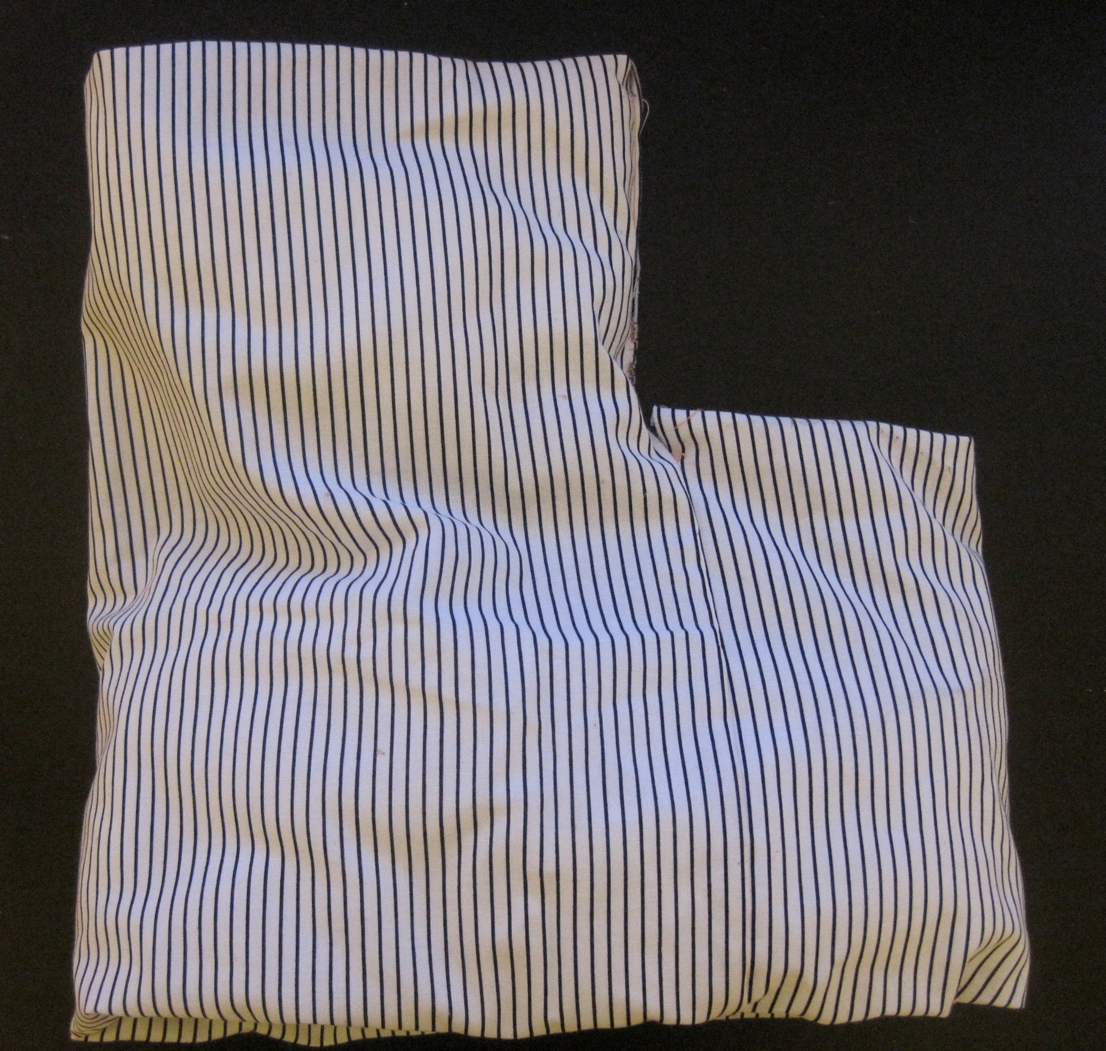 A black and white striped pillow