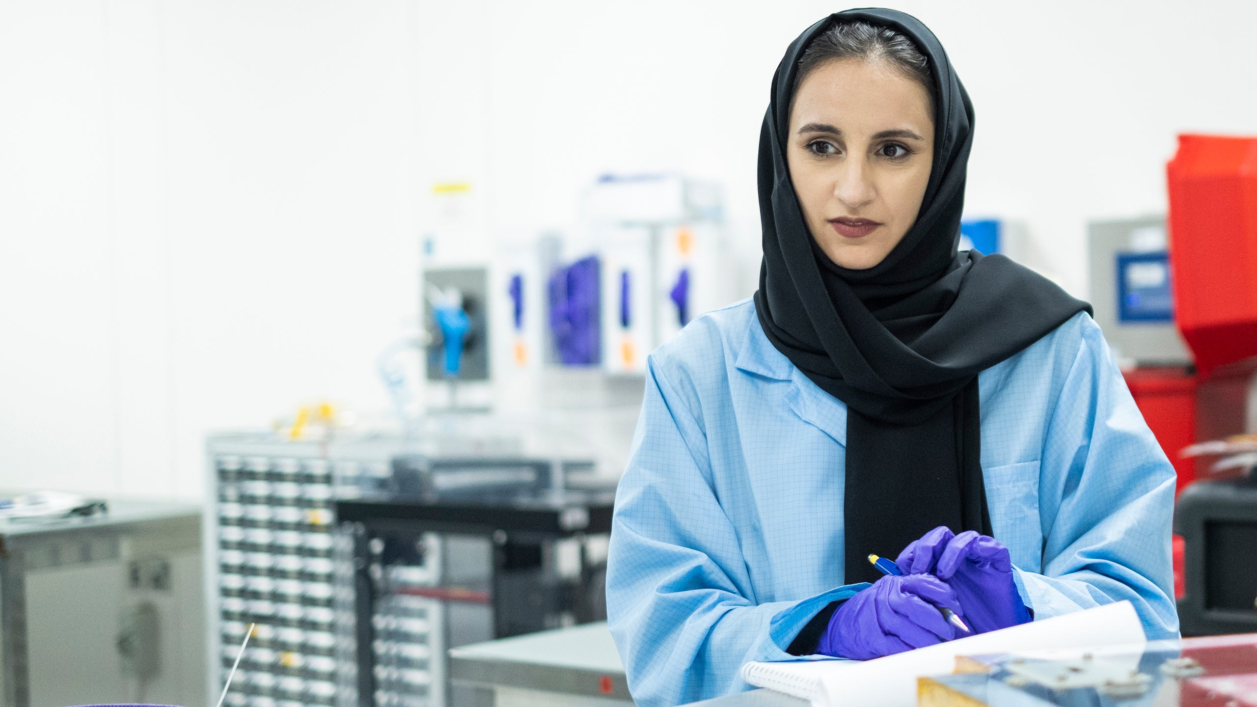 Ayesha Sharafi makes notes in the lab at the The Mohammed Bin Rashid Space Centre