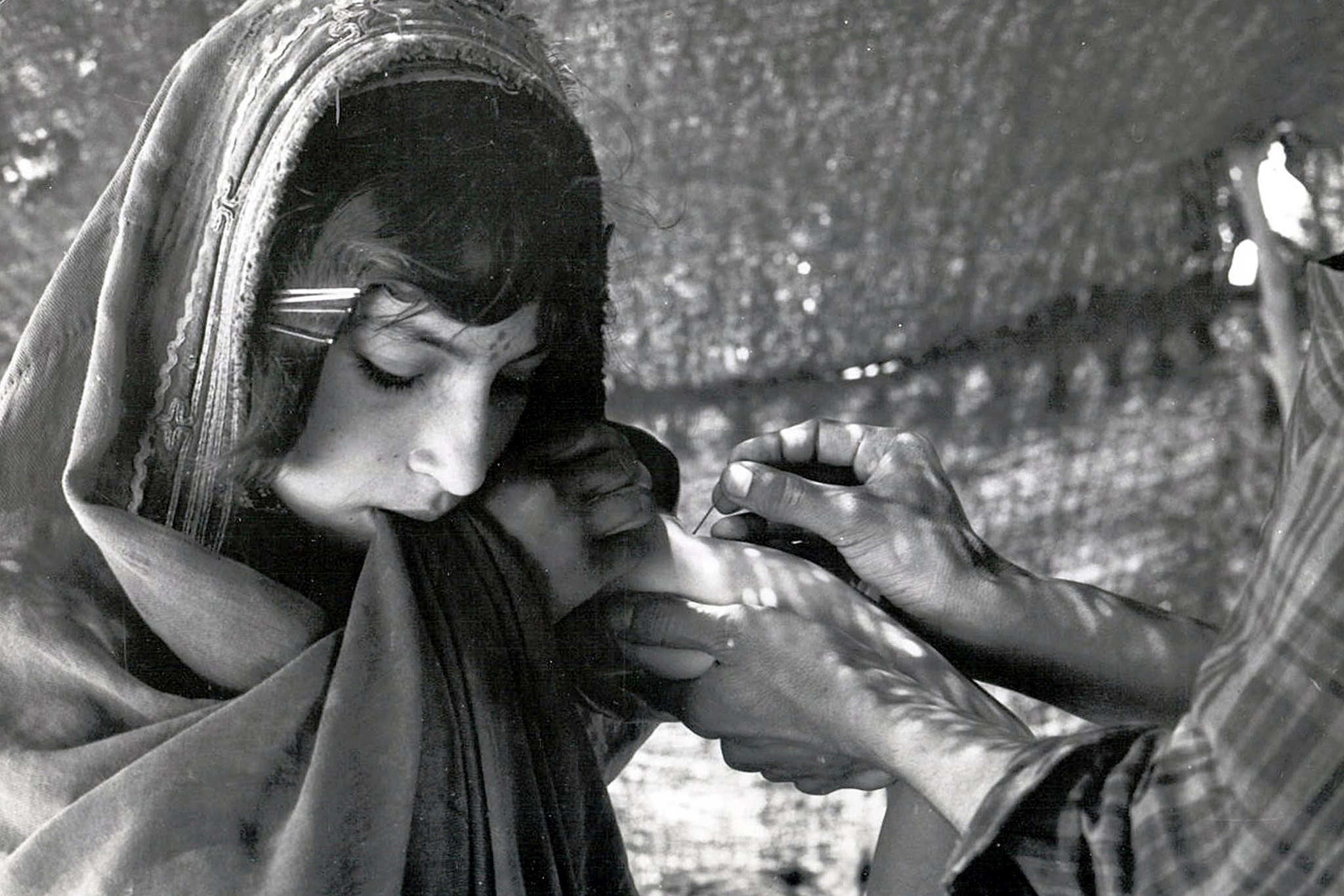 A girl in Afghanistan is vaccinated against smallpox in the 1970s.