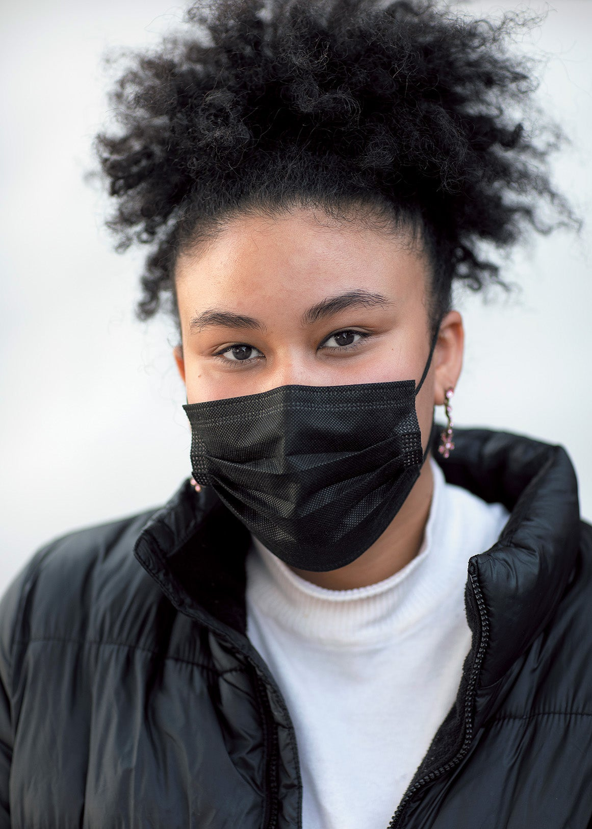 Layla Sayed, a young woman wearing a face mask.