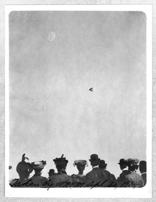 Onlookers watch a flight