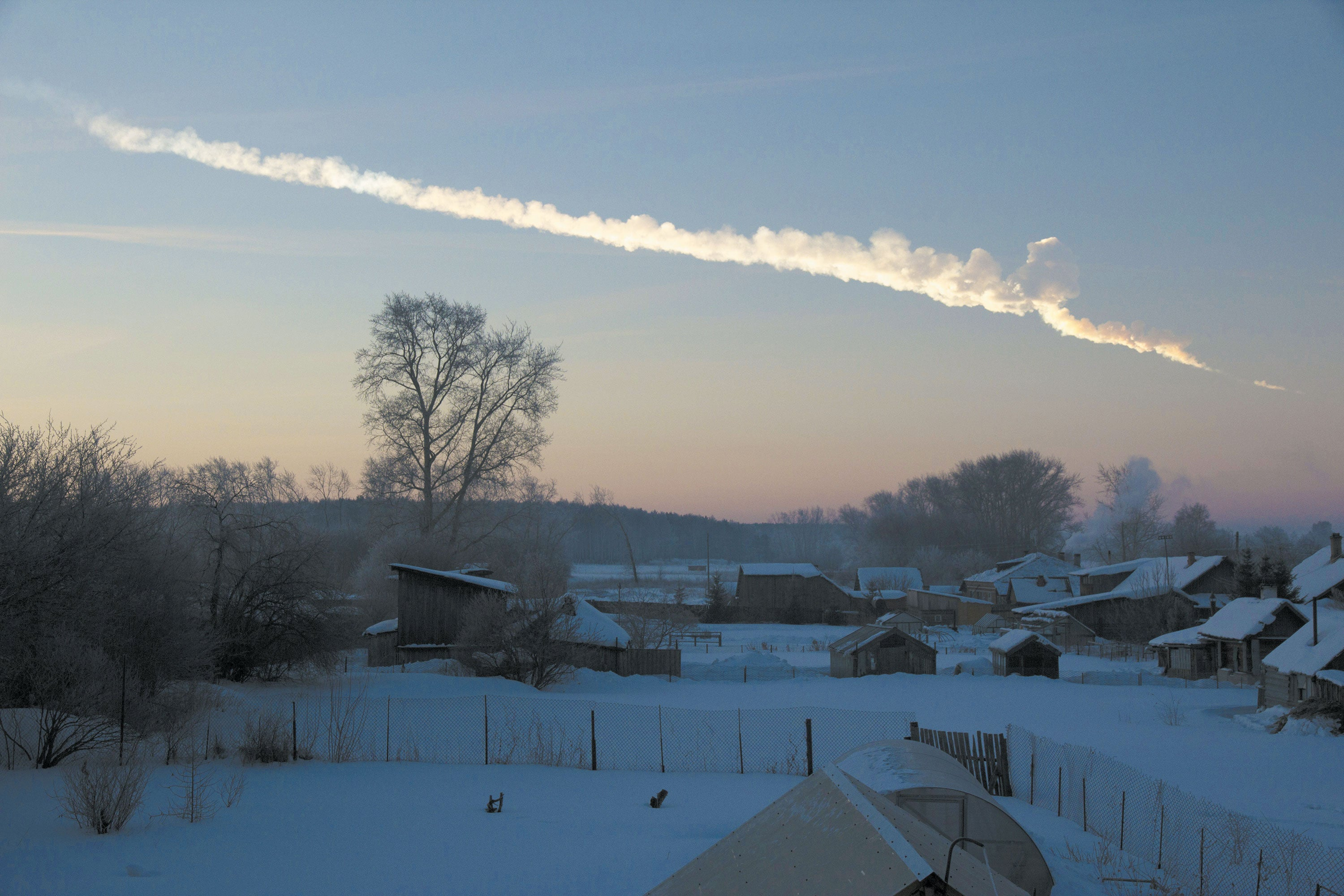 An asteroid the size of a house as it entered Earth's atmosphere and exploded over Chelyabinsk, Russia in 2013.