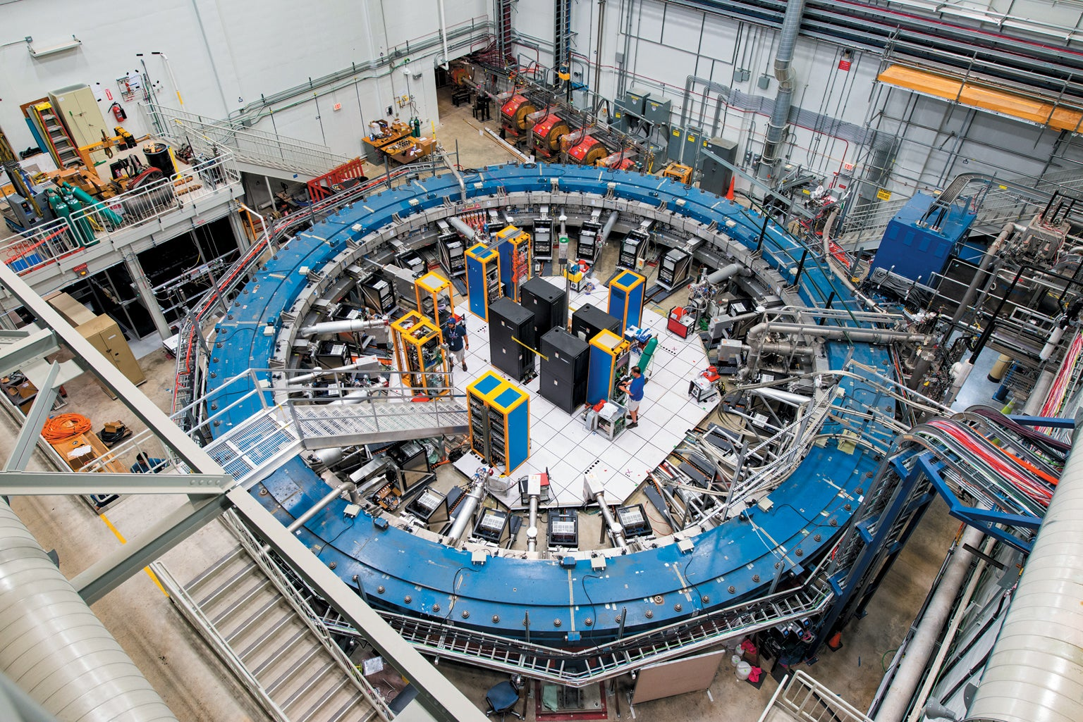 Particles circle around a 50-foot-diameter ring in the Muon g-2 experiment.