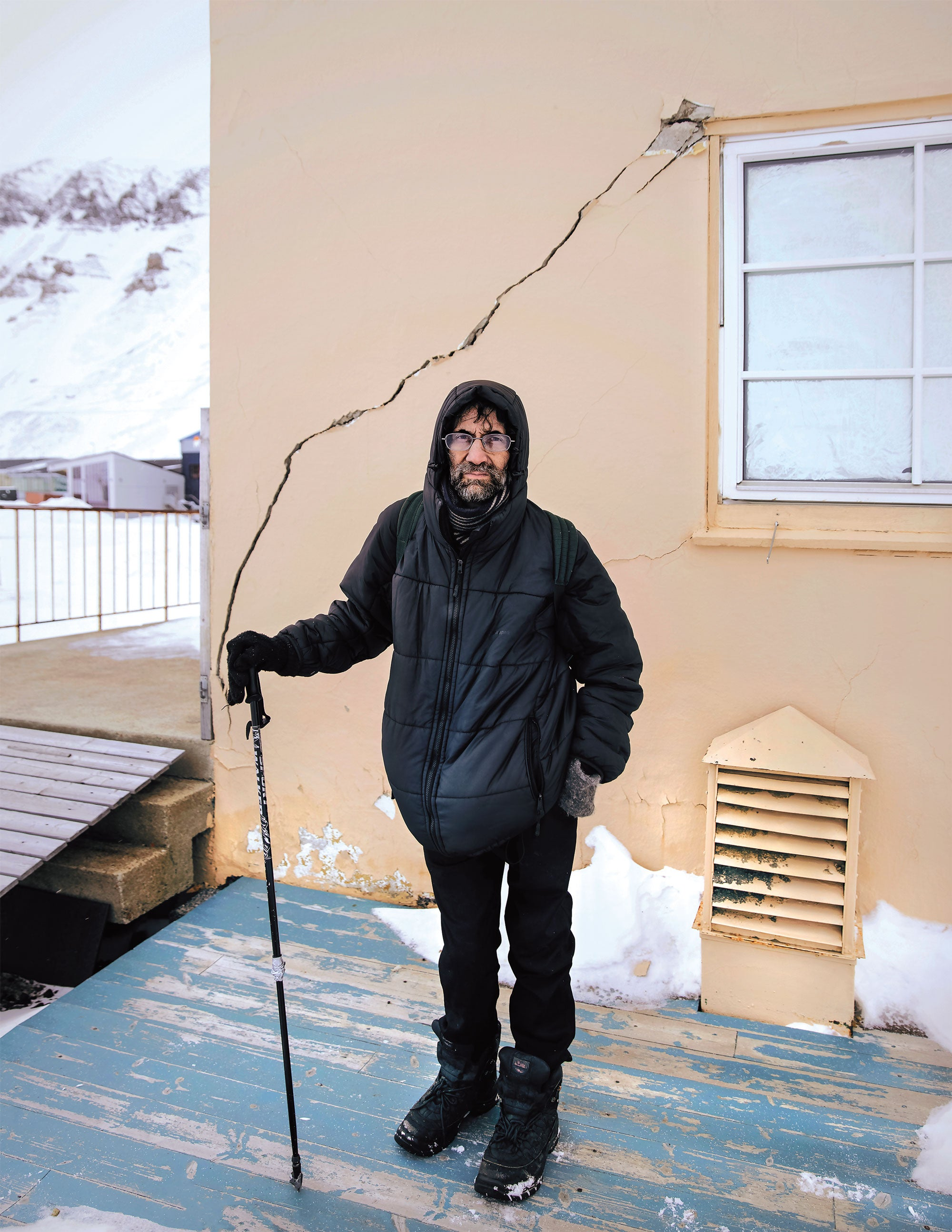 Mark Sabbatini standing outside a damaged apartment.