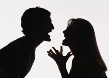 couple arguing in silhouette