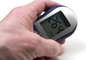 blood sugar monitor held in hand