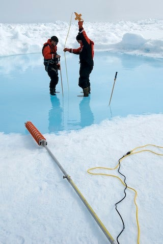 Chris Polashenski and Don Perovich at melt pond in Arctic