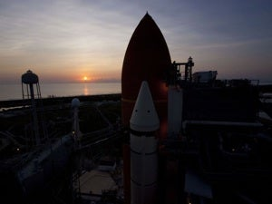 Shuttle Atlantis on the launch pad at sunset