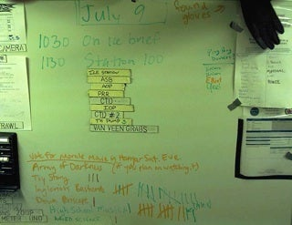 white board with plans on it