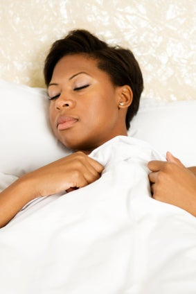 woman sleeping, which might be key to helping body lose extra fat