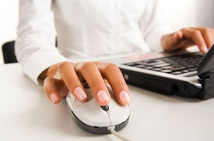 female using computer mouse