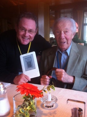 Steve Mirsky and Christian De Duve with Kindle copy of his 2010 book