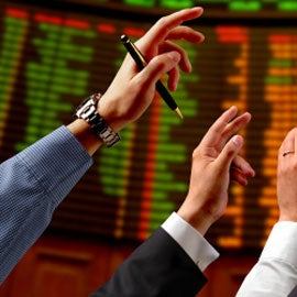 stock traders in global financial marketplace