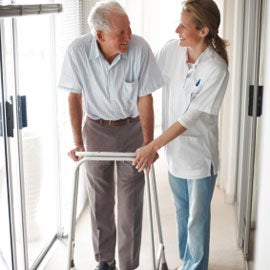 elderly man with walker to prevent falls