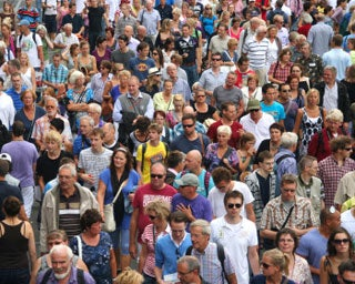 crowd of people on crowded planet of 7 billion