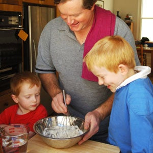 parent doing science at home kitchen with children bring science home