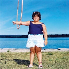fat-chid-exercisiing-hula-hoop-on-arm