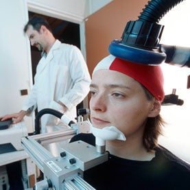 woman having consiousness measured