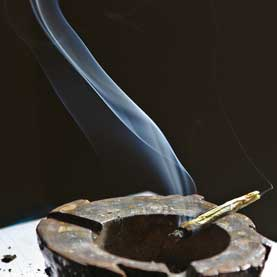 marijuana cigarette burning in an ash tray