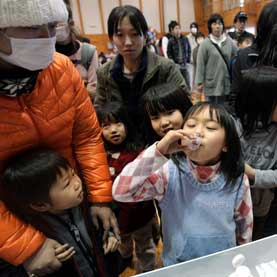 A young Japanese girl takes medication.