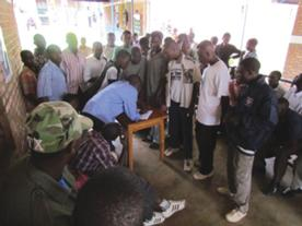 rwanda investigating adult male circumcision without anesthesia 1 Men waiting in line to get circumcised with new PrePex device.