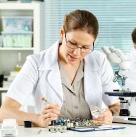 woman engineer working on circuit board