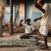 Stripping bark for rope-weaving.