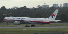 image of an airplane that says malaysia taking off