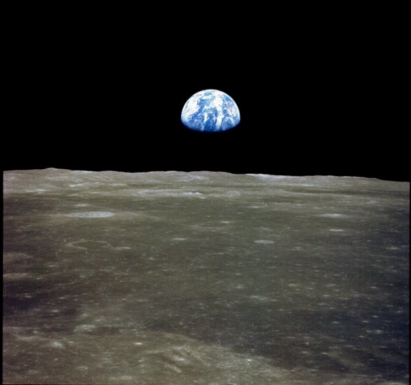 When Neil Armstrong and Buzz Aldrin touched down on the moon in July 1969 , they became the first humans to view Earth f