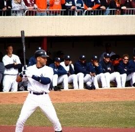 Derek Jeter at home base, bat in hand.