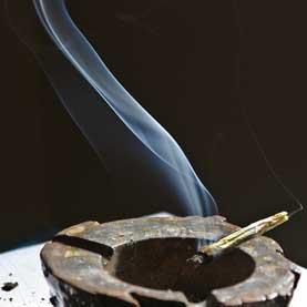 marijuana cigarette burning in an ash tray