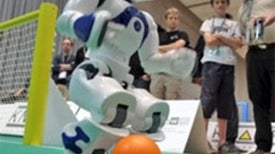 RoboCup 2010: Could Robot versus Human Be Far Behind? [Slide Show]