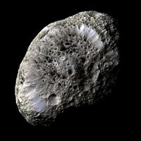 Saturn's Moon Hyperion Is Porous like a Sponge