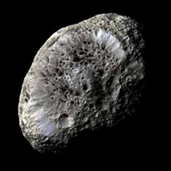 Saturn's Moon Hyperion Is Porous like a Sponge