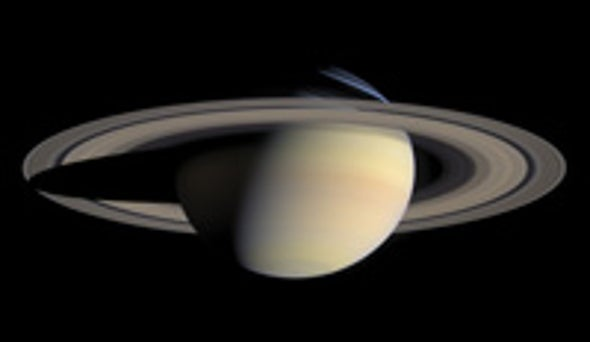 Saturn Submits to a Planetary Paparazzo