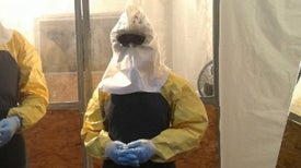 Working in an Ebola Protection Suit