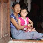 67-year-old Daw Ngwe Tein babysits her 3-year-old grandchild, Blu Nay L'Paw. Blu's mother works as a clinician in the Shoklo Malaria Research Unit (SMRU ) at Mae Sot, Thailand near the Myanmar border.