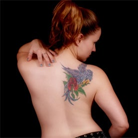tatoo on woman's back shoulder