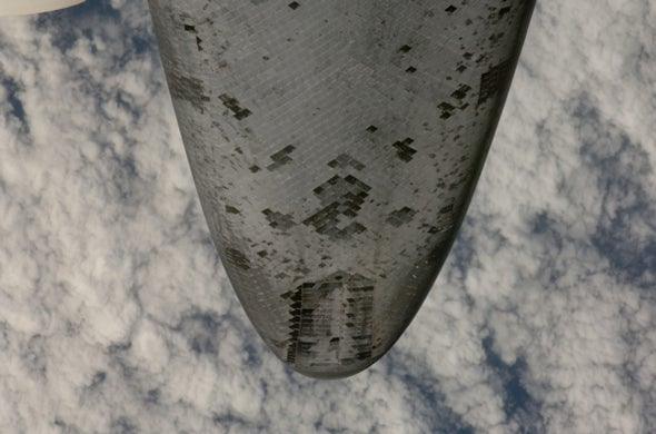 Photo of space shuttle's belly shows dings
