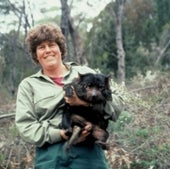 AUTHOR CARRYING A CAPTURED ANIMAL