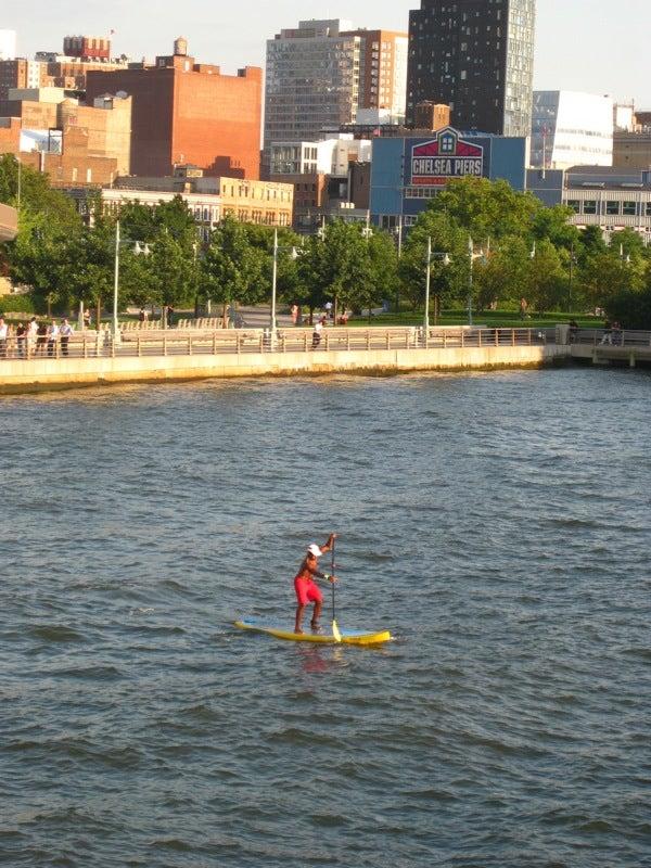 City View: Paddle Surfers Enjoy New York's Waterways