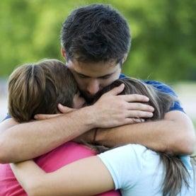 man-hugging-children