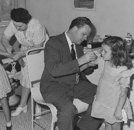 School children being vaccinated by doctors for smallpox in 1946.