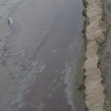 sand-berm-stops-oil