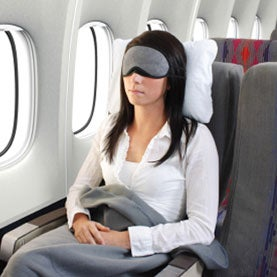 sleeping woman on an airplane