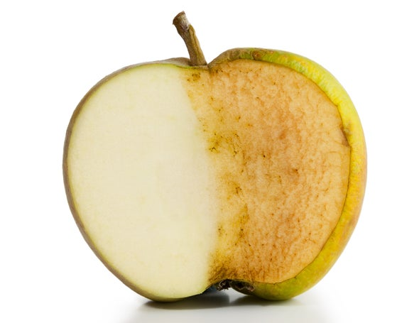 Why do apple slices turn brown after being cut?