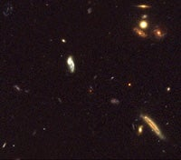 Mature Galaxies in Young Universe At Odds with Theory