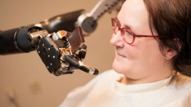 What Is It Like to Control a Robotic Arm with a Brain Implant?