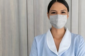 From behind the Coronavirus Mask, an Unseen Smile Can Still Be Heard