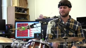 Robotic Arm Allows Three Armed Drumming